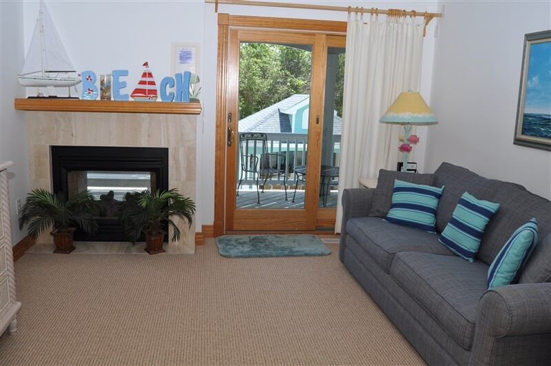 JASMINE BAY Den with Double-sided Fireplace